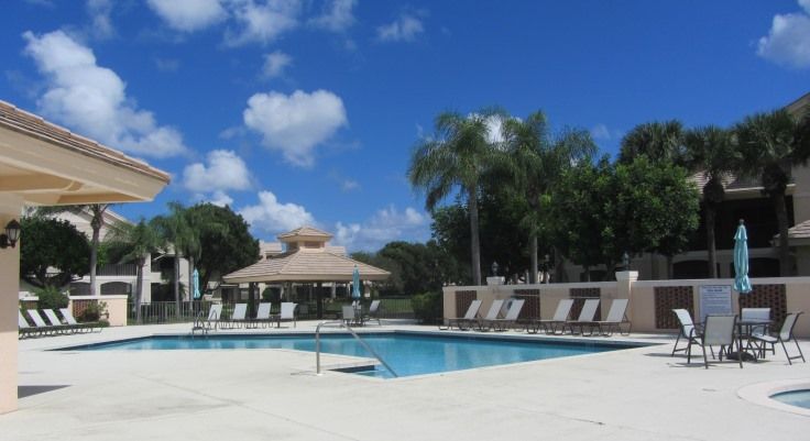 West Bay at Jonathan's Landing in Jupiter, Florida offers beautiful lake front town-homes in a country club setting.