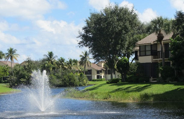 West Bay at Jonathan's Landing in Jupiter, Florida offers beautiful lake front townhomes in a country club setting.